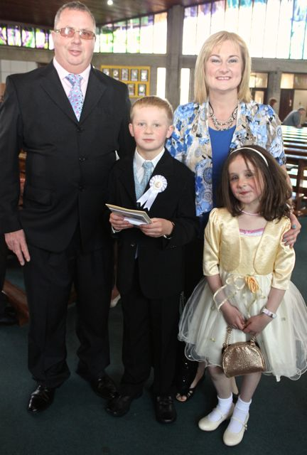 Fionn Bermingham of Holy Family NS who made his First Holy Communion on Saturday in Our Lady and St Brendan's Church, pictured with his family, Tom, Patricia and Bronagh . Photo by Dermot Crean