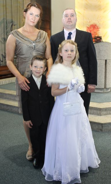 Natalia Peczak of Holy Family NS who made her First Holy Communion on Saturday in Our Lady and St Brendan's Church, pictured with her family parents Beata and Tomsz and Adam. Photo by Dermot Crean