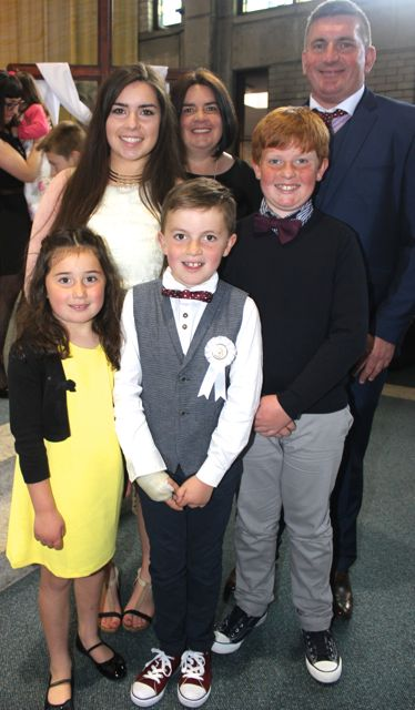 Jamie McCarthy of Holy Family NS who made his First Holy Communion on Saturday in Our Lady and St Brendan's Church, pictured with his family, parents Cathy and Simon and siblings Fia, Ava and Sam. Photo by Dermot Crean