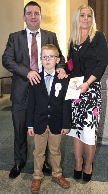 Daniel O'Connell of Holy Family NS who made his First Holy Communion on Saturday in Our Lady and St Brendan's Church, pictured with his parents Kevin and Magda. Photo by Dermot Crean