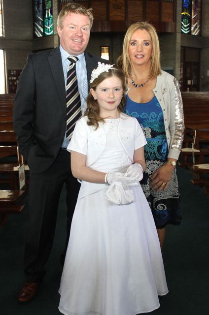 Parents Norman and Elaine Foley with Rachel making her First Holy Communion at Our Lady and St Brendan's Church on Saturday morning. Photo by Dermot Crean