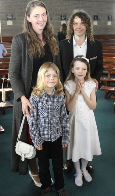 Dora Daly, who made her First Holy Communion at Our Lady and St Brendan's Church on Saturday morning, with family Susan, Billy and Paddy Photo by Dermot Crean