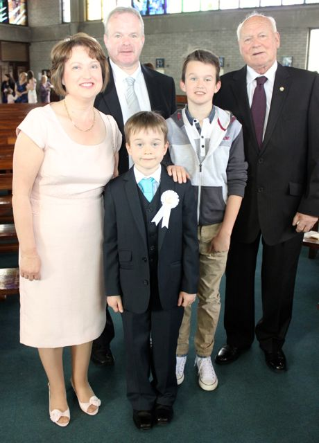 Padraig O'Connell who made his First Holy Communion at Our Lady and St Brendan's Church on Saturday morning, with family, Carmel and Sean, Morgan and Patrick Lynch (grandfather). Photo by Dermot Crean