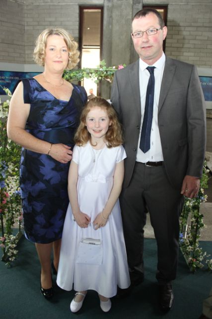 Maeve Trant who made her First Holy Communion at Our Lady and St Brendan's Church on Saturday morning, with parents Katie and Diarmaid Trant. Photo by Dermot Crean