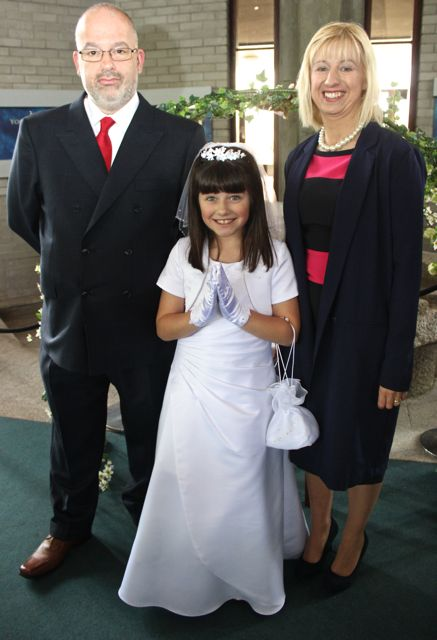 Emma Dunican, who made her First Holy Communion at Our Lady and St Brendan's Church on Saturday morning, with parents Tom and Oonagh. Photo by Dermot Crean