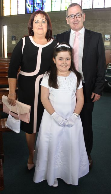 Amy Behan, who made her First Holy Communion at Our Lady and St Brendan's Church on Saturday morning, with parents Aisling and Vincent Photo by Dermot Crean