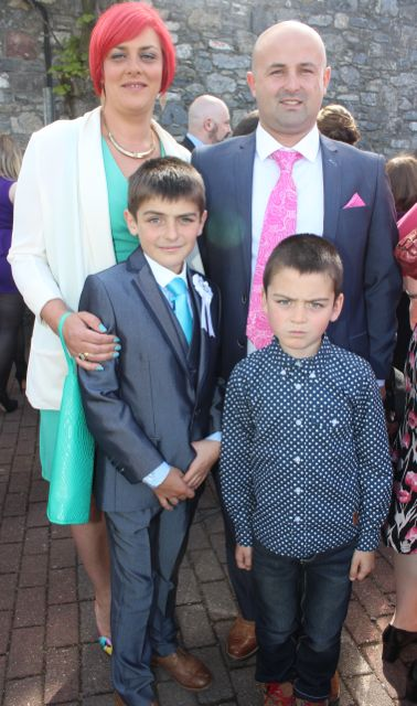 Leo Keane, who made his First Holy Communion at St John's Church on Saturday morning, with Tracy O'Sullivan, Mike Connolly and Conor Keane. Photo by Dermot Crean