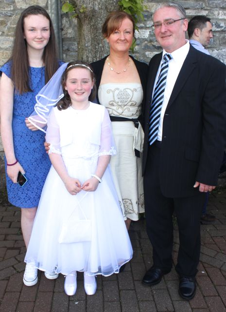 Lauren Doody who made her First Holy Communion at St John's Church on Saturday morning, with parents Adrian and Shirley and sister Aoife. Photo by Dermot Crean