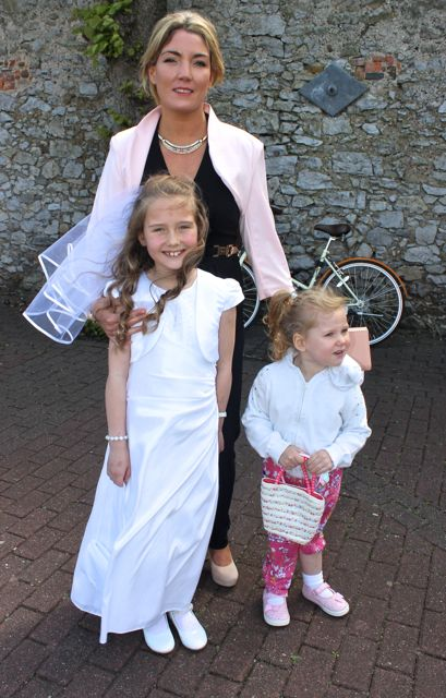 Carla Wisniewski of Presentatation Primary who made her First Holy Communion on Saturday in St John's Church, pictured with her mother Andrea Brosnan and sister Victoria. Photo by Dermot Crean