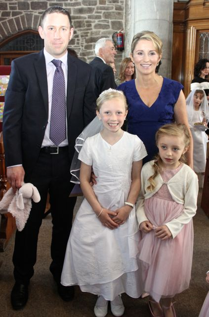 Katelyn Leen of Presentatation Primary who made her First Holy Communion on Saturday in St John's Church, pictured with her family, Kenneth and Catriona Leen and sister Jessica. Photo by Dermot Crean