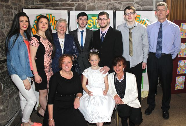 Cassandra Knightly of Presentatation Primary who made her First Holy Communion on Saturday in St John's Church, pictured with her family. Front from left; Bridie Hanafin and Marian Knightly. Back from left; Geraldine Knightly, Marian Knightly, Mary Hanafin, Stephen Knightly, Justin Knightly, Martin Knightly and Martin Knightly. Photo by Dermot Crean