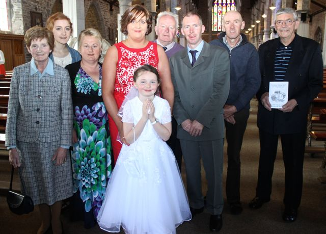 Rachel Prenderville of Presentatation Primary who made her First Holy Communion on Saturday in St John's Church, pictured with her parents Ann Marie and Noel, (standing to her left and right), Marie Daly, Aisling O'Neill, Noreen O'Neill, Michael Daly, Alan O'Neill and Bernard Croxford. Photo by Dermot Crean