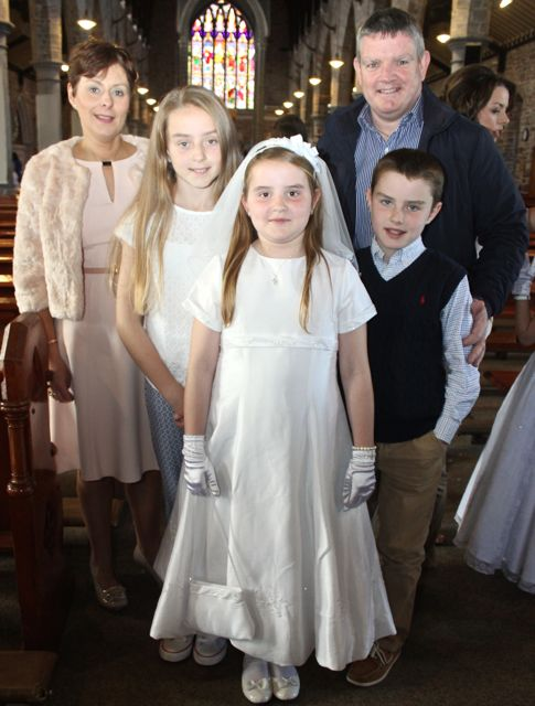 Aoife Barrett of Presentatation Primary who made her First Holy Communion on Saturday in St John's Church, pictured with her parents Siobhan  and Mike, sister Sarah and brother Sean. Photo by Dermot Crean