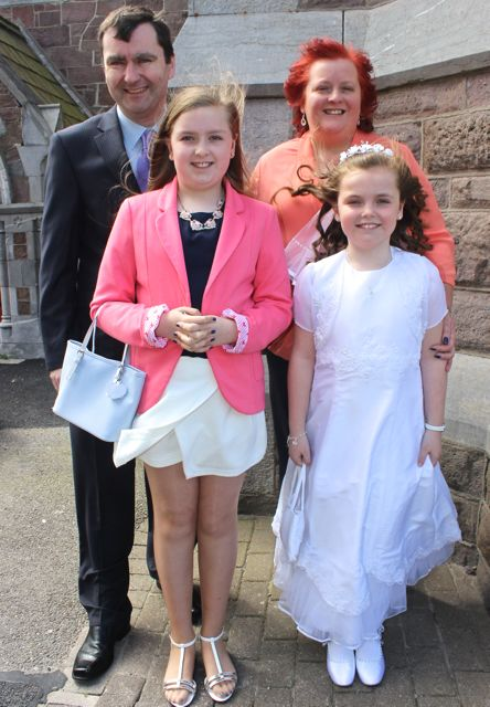 Aisling O'Donnell of Presentatation Primary who made her First Holy Communion on Saturday in St John's Church, pictured with her family John and Jill and sister Emma. Photo by Dermot Crean