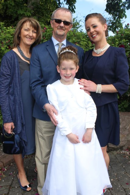 Ella O'Donoghue of Presentatation Primary who made her First Holy Communion on Saturday in St John's Church, pictured with her mom Deirdre and grandparents Anne and Johnny O'Donoghue. Photo by Dermot Crean