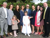 Ella O'Donoghue of Presentatation Primary who made her First Holy Communion on Saturday in St John's Church, pictured with her family, from left; Derry Healy, Catherine Walsh, Cara Kelliher, Helen Kelliher, Anne, Johnny and Deirdre O'Donoghue, Sinead, Niamh and Tom Walsh. Photo by Dermot Crean