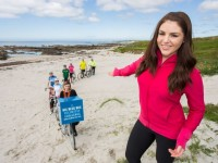 No Repro Fee 26-5-2015 Picture shows Galway Girl Sile Seoige (foreground at right) launching the Bank of Ireland Big Blue Box Volunteer Challenge in aid of St Vincent De Paul along the Galway coast . The initiative will run from the 5th until the 19th of June involving 35 communities along the Wild Atlantic Way. The big Blue Box will travel from town to town by bike with the aim of raising money for the local SVP with members of the local community and Bank of Ireland staff set to travel 1,237 kilometres in total. For information on how to get involved with this fundraising event please visit: www.bankofireland.com/BigBlueBox Pic:Naoise Culhane-no fee