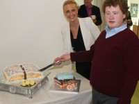 St Ita's and St Joseph's School Principal, Grace Sheahan, helps student Luke Scollard cut the cake he made specially to mark the opening of the new extension to the school. Photo by Dermot Crean