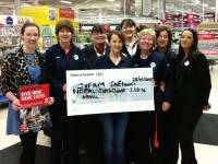 Eileen Hanlon from Oxfam Tralee being presented with a cheque from workers at Tesco in Manor West.