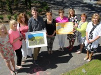 At the launch of the Spa/Fenit Hospice Committee Midsummer Art Exhibition in aid of the Palliative Care Unit in Kerry General Hospital were, from left: Sally Ryle, Jane Hilliard, Maureen O'Mahony, John Hurley, Mairead Moriarty, Margaret O'Shea, Nuala Finnagan, Noreen O'Leary and Mary McSwiney. Photo by Gavin O'Connor.