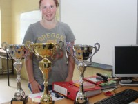 Danielle O'Sullivan, with the three trophies she won at the World Drug Free Powerlifting Association Championships in England. Photo by Gavin O'Connor.