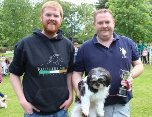 Giles Kelliher of Kelliher's Farm and Pet Supplies (sponsors) with Joseph O'Connor and 'Dolly', Dog of the Show winner at the Féile na mBláth Dog Show in the Town Park on Saturday. Photo by Dermot Crean