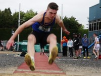 Winner of the Minor Boys Long Jump competition, Sean Quilter, from Tralee CBS in action. Photo by Adrienne McLoughlin.