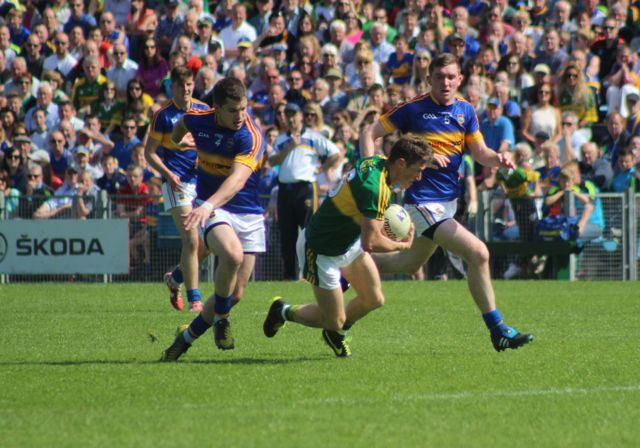 Jonathan Lyne, takes a challenge, from Tipperary's, Robbie Kiely. Photo by Gavin O'Connor.