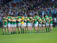 The Kerry team stand for the national anthe, 15 minutes later than expected. Photo by Dermot Crean.