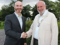 President of Tralee Rotary Club Derry O'Sullivan congratulates incoming President, Richard Bono. Photo by Dermot Crean