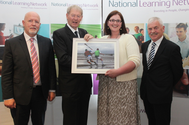 Photographer, Breda Canty who came through the National Learning Network, Tralee, presented a photo to guest of honour Micheal O'Muircheartaigh. They are pictured with (left) Christy Enright Kerry ETB and Pat O'Neil, manager of the National Learning Network. Photo by Gavin O'Connor.