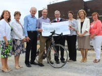 Joe Moriarty and Ray Moynihan, handing over a cheque to the Paliative Care Unit in Kerry General Hospital, from left: Mairead Moriarty, Margaret O'Shea, Joe Moriarty, Ray Moynihan, Ted Moynihan, Marie O'Connell, Marie McSwiney and Noreen O'Leary. Photo by Gavin O'Connor.
