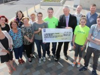 At the Walk of Life, check presentation were, from left: Deirdre Fee, Katrina Locke, Mary Young, Mary O'Sullivan, Delores Gallagher, Albha Foley, Lorraine Bowler, Colin Ahern, Jimmy Mulligan, Justin Duggan, Kayleigh O'Regan McCannon,  Donna Hennebery and Mark Lynch. Photo by  Gavin O'Connor.