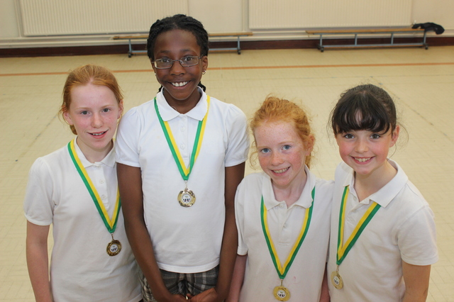 The Gaelscoil Mhic Easmainn pupils who won the gold medal in the relay race at the Kerry Primary Schools Championship, from left are: Roise Ni Dhomhnaill, Jane Akinrin, Aoife Ni Ruairc and Cuileann Nic Gabhan. Photo by Gavin O'Connor.