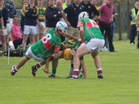 Kilmoyley's, Darren Twomey, comes under pressure from Crotta's, Tomas O'Connor and Shane Nolan. Photo by Dermot Crean.