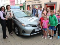 Suzanne Ennis, from Tralee Credit Union hands over the keys of a brand new Toyota Aurus, to Catherine Moriarty, winner of the Credit Union Members Draw. Photo by Gavin O'Connor.