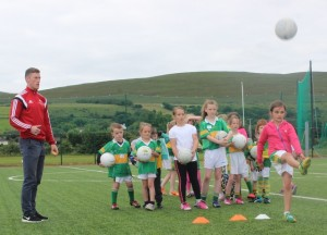 Kerry footballer, Jonathan Lyne, oversees some skills training at the John Mitchels GAA Summer Camp. Photo by Gavin O'Connor.