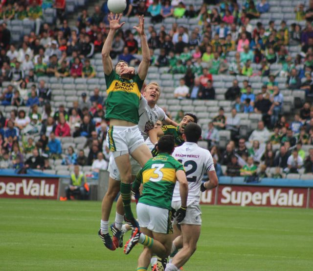 David Moran, rises up with Kildare's Paul Cribbon. Photo by Dermot Crean.