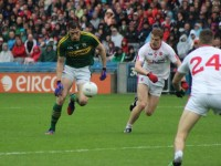 David Moran, runs passed Tyrone's Peter Harte, in the All-Ireland SFC smi-final last month. Photo by Dermot Crean.