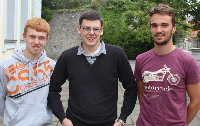 Gaelcholaiste Ciarrai students Dylan De Búrca, Jack Mac Coitir and Neil ó Caoileán collecting their results early this morning. Photo by Fergus Dennehy.