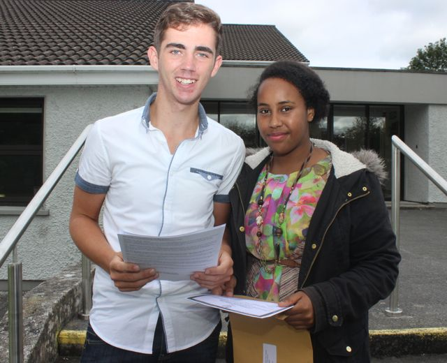 Darragh McGinley and Aisha Sharif Hassan with their Leaving Cert results at Coláiste Gleann Lí on Wednesday morning. Photo by Dermot Crean