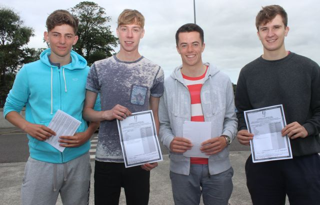 Jack Murray, Patrick Walsh, Darragh McGarty and Marcos Prendiville with their Leaving Cert results at Mercy Mounthawk on Wednesday morning. Photo by Dermot Crean