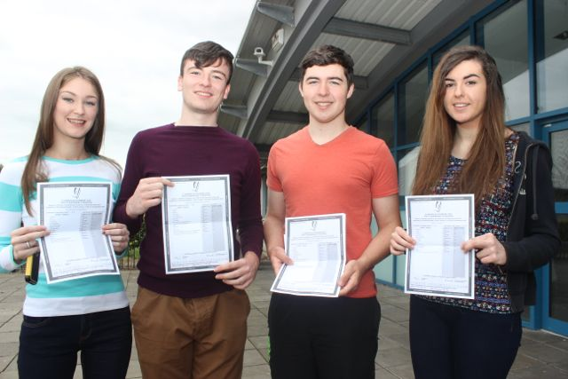 Clodagh Fitzgerald, Kevin McCarthy, Diarmaid Moriarty and Iseult Daly with their Leaving Cert results at Mercy Mounthawk on Wednesday morning. Photo by Dermot Crean