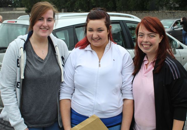 Presentation students Rebecca McGovern, Sheila Gaynor and Michelle Lynch collecting their results early this morning. Photo by Fergus Dennehy.
