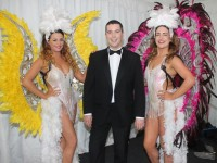 Sarah Griffin and Tara Dore with the host for the evening, Brian Hurley, at the Austin Stacks' Strictly Come Dancing in the Dome on Saturday night. Photo by Dermot Crean