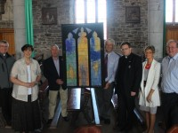 In St John's Church in Ashe Street with a representative drawing of the planned new stained glass window were, from left: Fr Sean Hanifin, Cllr Norma Foley, Bill Looney, Denis Kelliher, Fr Bernard Healy, Cathrine Dwyer and John Griffin. Photo by Gavin O'Connor.