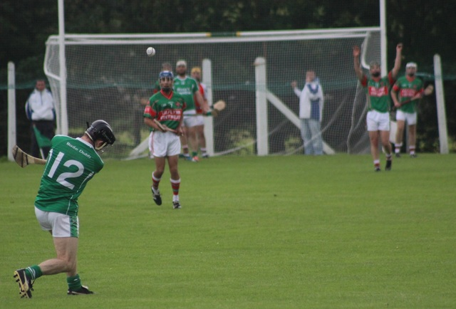 Ballyduff's Bobby O'Sullivan launches a shot during the match on Tuesday night. Photo by Gavin O'Connor