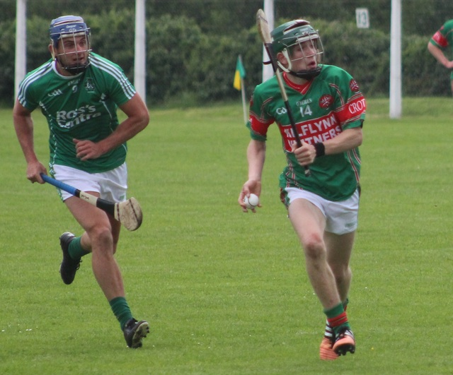 Jordan Conway of Crotta chased by Giles O'Grady the match on Tuesday night. Photo by Gavin O'Connor