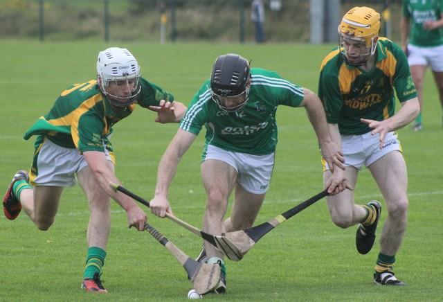 Ballyduff's, Bobby O'Sullivan, has his work on his hands trying to get on the ball. Photo by Gavin O'Connor.