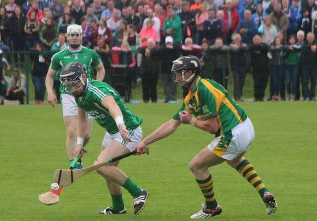 Ballyduff's, Dougie Fitzell and Kilmoyley's, James McCarthy, tussle for the ball. Photo by Gavin O'Connor.